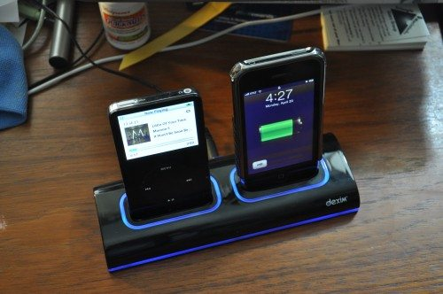 A full-sized iPod and an iPhone 3G charging. Notice the illumination is turned on.