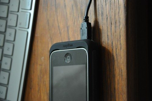 iPhone in Mophie with charging cable attached
