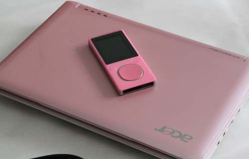 Acer Aspire One in Pearl Pink with Zune.  Zune sold separately.