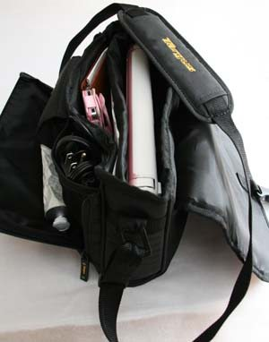 I can carry my netbook, power cords, mouse, checkbook, pens, lipstick, keys and handcream.  Large wallets won't work so I use a small coin purse with slots for ID.  Works perfectly.