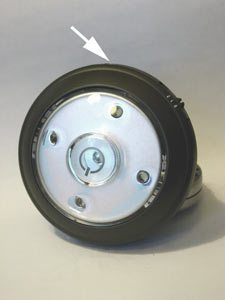 "An auto-sensing LED ""puck"" light (arrow points to optical sensor)"