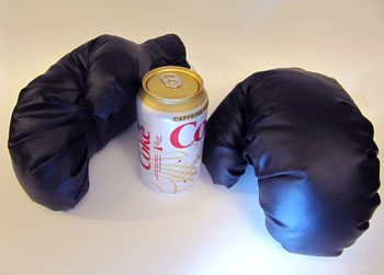 Boxing gloves -- pop can used for scale