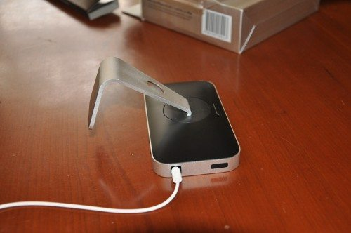 Facedown on the table, you can see the swivel of the base, as well as the iPhone release button.