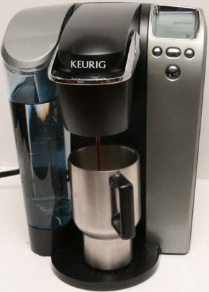 Keurig Platinum brewer in the process of brewing