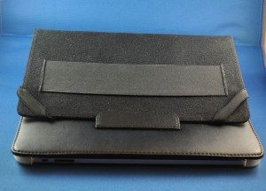 Corner straps and the hand strap shown with front cover tucked into back tab.