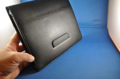 Flap on rear of case holds front cover to form a typing stand.