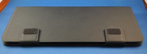 Bottom of the InCase Origami Workstation, showing hook-and-loop tabs on closure straps.