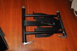 """The Crane Stand Pro folded for travel. It's less than 2"""" thick in this position!"""