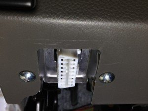 The OBD port under the dash of my car.