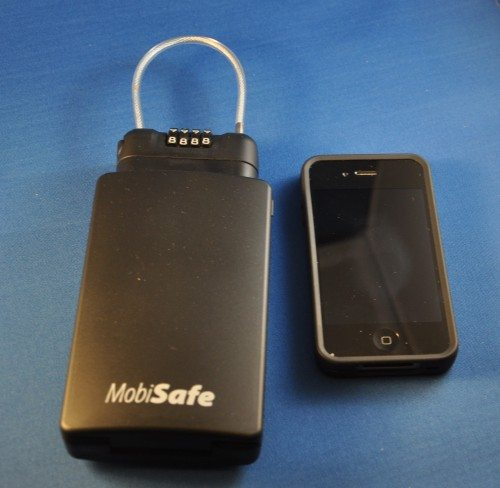 MobiSafe next to an iPhone 4 for size comparison.