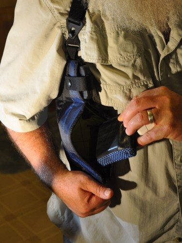 Right-side holster, showing iPhone 4s strapped in above lower pocket with Waterfield wallet being inserted.ld