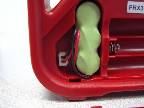 Rechargeable batteries come unplugged from the factory.  Plug it in and you're up and running.