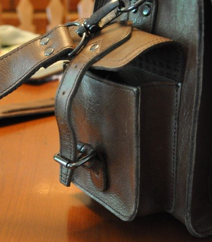 The side pockets, unlike the main flap pocket, can only be accessed from a true buckle, which tends to be clumsy and time-consuming.