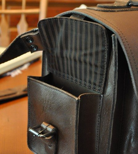 The side pockets, as with the rest of the interior, are lined with a striped fabric, and double-stitched on the flap.