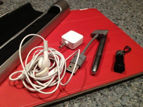 It all fits: Apple Earbuds, a Fisher Space Pen, a Square dongle, an Encase USB-30-pin cable, and a Streamlight Nanolight.