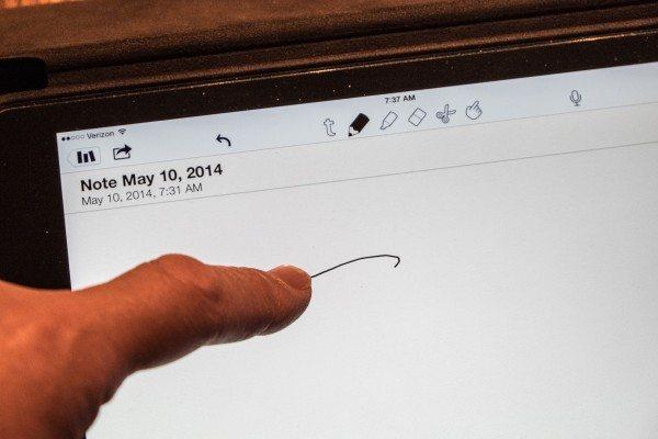17) Finger on iPad
