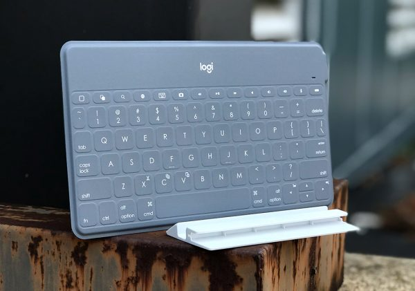 Logitech KEYS-TO-GO bluetooth keyboard leaning next to metal pole