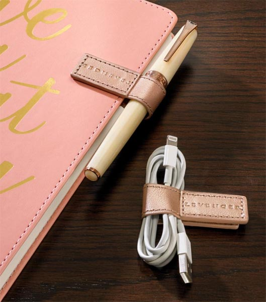 61028ef1ad9 NEWS – These versatile leather-covered magnetic clips from Levenger serve  many functions. You can use them as cable organizers for earbuds or  charging ...