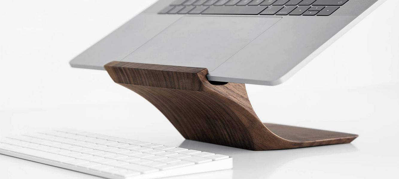 The YOHANN Wooden MacBook stand artfully elevates your laptop